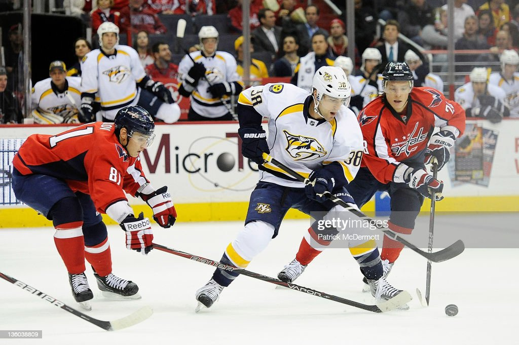 <a gi-track='captionPersonalityLinkClicked' href=/galleries/search?phrase=Jack+Hillen&family=editorial&specificpeople=5088928 ng-click='$event.stopPropagation()'>Jack Hillen</a> #38 of the Nashville Predators battles for the puck against <a gi-track='captionPersonalityLinkClicked' href=/galleries/search?phrase=Alexander+Semin&family=editorial&specificpeople=206654 ng-click='$event.stopPropagation()'>Alexander Semin</a> #28 of the Washington Capitals and Dmitry Orlov #81 of the Washington Capitals at Verizon Center on December 20, 2011 in Washington, DC.
