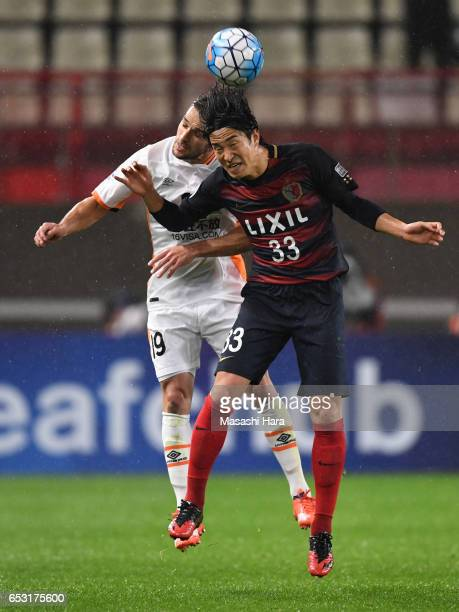 Jack Hingert of Brisbane and Mu Kanazaki of Kashima Antlers compete for the ball during the AFC Champions League Group E match between Kashima...