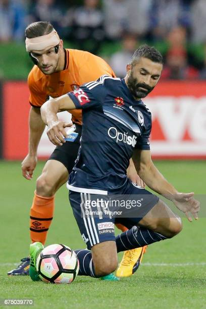 Jack Hingert of the Roar and Ben Khalfallah of the Victory compete for the ball during the ALeague Semi Final match between Melbourne Victory and the...