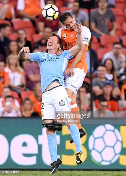 Jack Hingert of the Roar and Braedyn Crowley of Melbourne City challenge for the ball during the round seven ALeague match between Brisbane Roar and...
