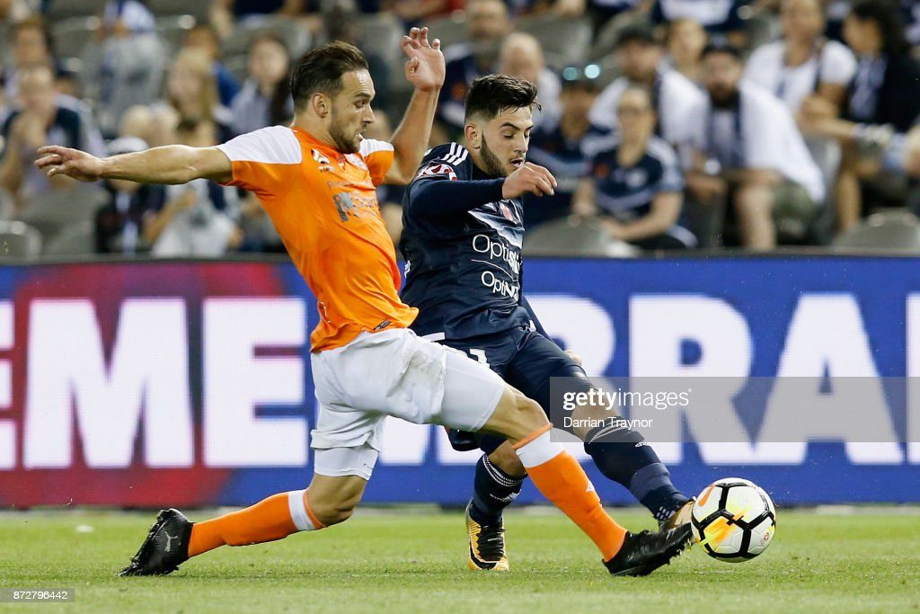 Jack Hingert of the Roar and Christian Theoharous of the Victory compete during the round six A-League match between the Melbourne Victory and Brisbane Roar at Etihad Stadium on November 11, 2017 in Melbourne, Australia.