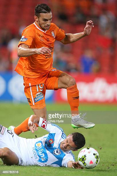 Jack Hingert of the Roar and Daniel Georgievski of Victory compete for the ball during the round 18 ALeague match between the Brisbane Roar and...