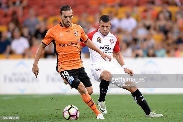 Jack Hingert of the Roar and Jaushua Sotirio of the Wanderers compete for the ball during the round 22 ALeague match between Brisbane Roar and...