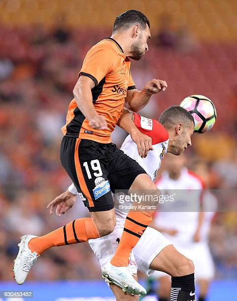 Jack Hingert of the Roar and Jaushua Sotirio of the Wanderers challenge for the ball during the round 22 ALeague match between Brisbane Roar and...
