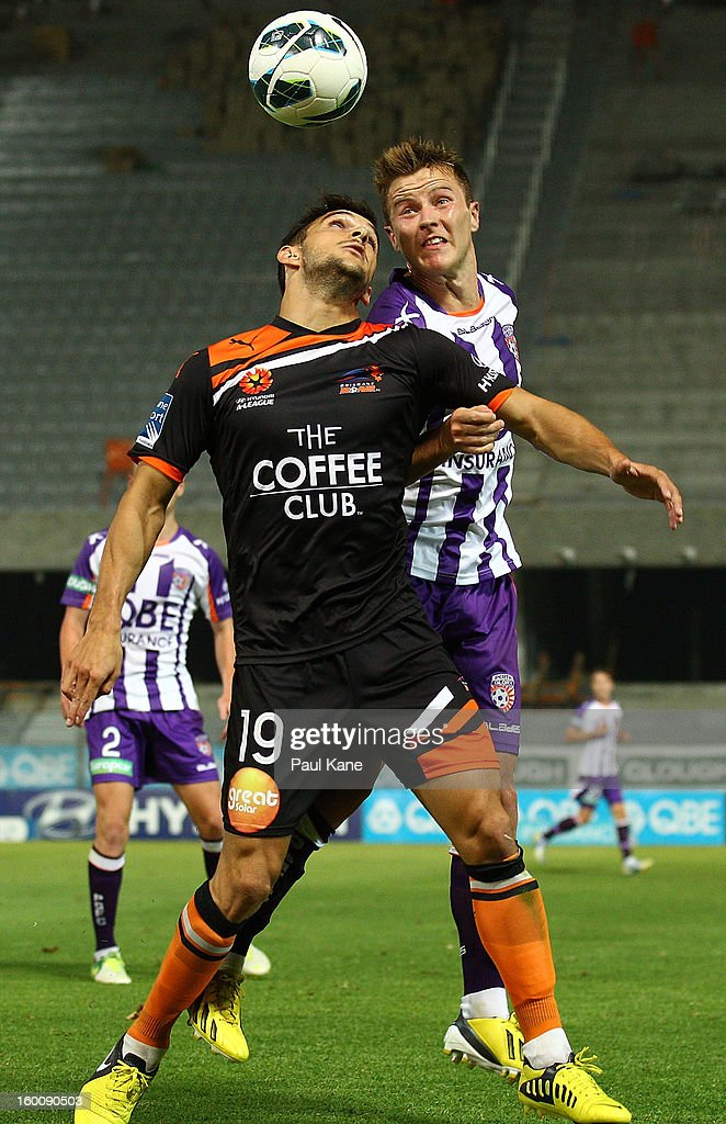 Jack Hingert (L) of the Roar and Scott Jamieson of the Glory contest for the ball during the round 18 A-League match between the Perth Glory and the Brisbane Roar at nib Stadium on January 26, 2013 in Perth, Australia.