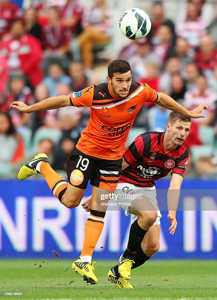 Jack Hingert of the Roar competes with Shannon Cole of the Wanderers during the round ten A-League match between the Western Sydney Wanderers and the Brisbane Roar at Parramatta Stadium on December 9, 2012 in Sydney, Australia.