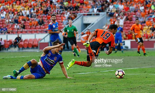Jack Hingert of the Roar is brought down in the box to earn a penalty during the round 14 ALeague match between the Brisbane Roar and the Newcastle...