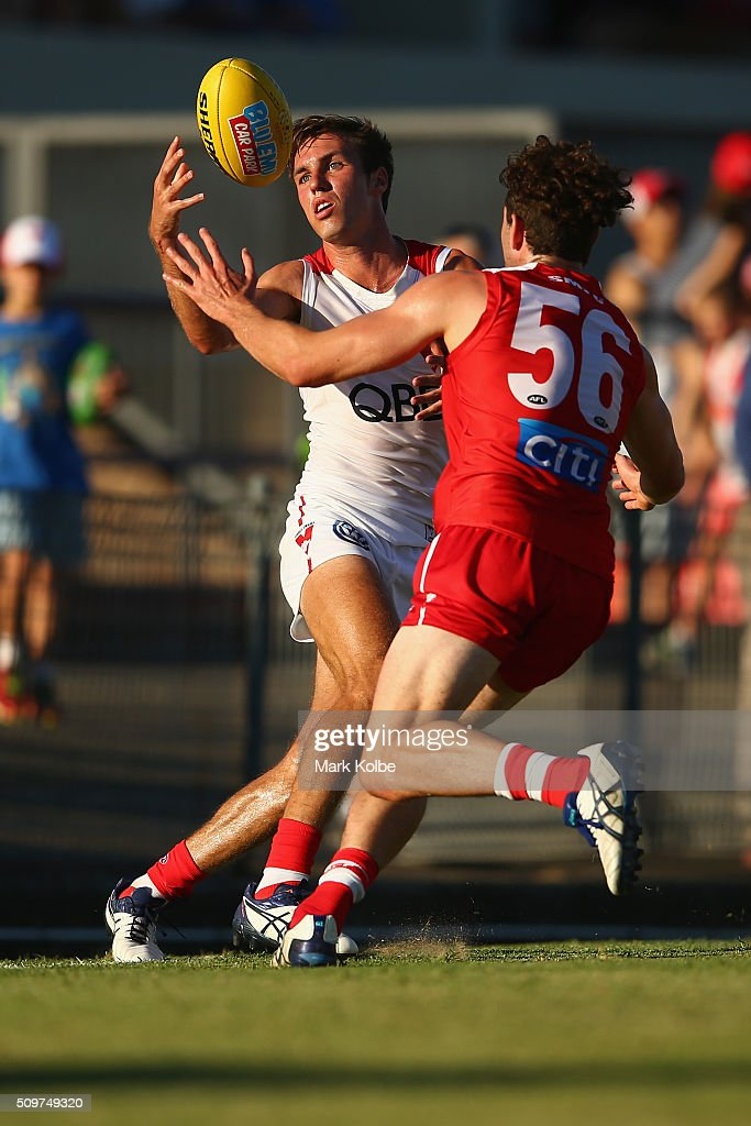 Jack Hiscox of the White Team is tackled during the Sydney Swans AFL intra-club match at Henson Park on February 12, 2016 in Sydney, Australia.