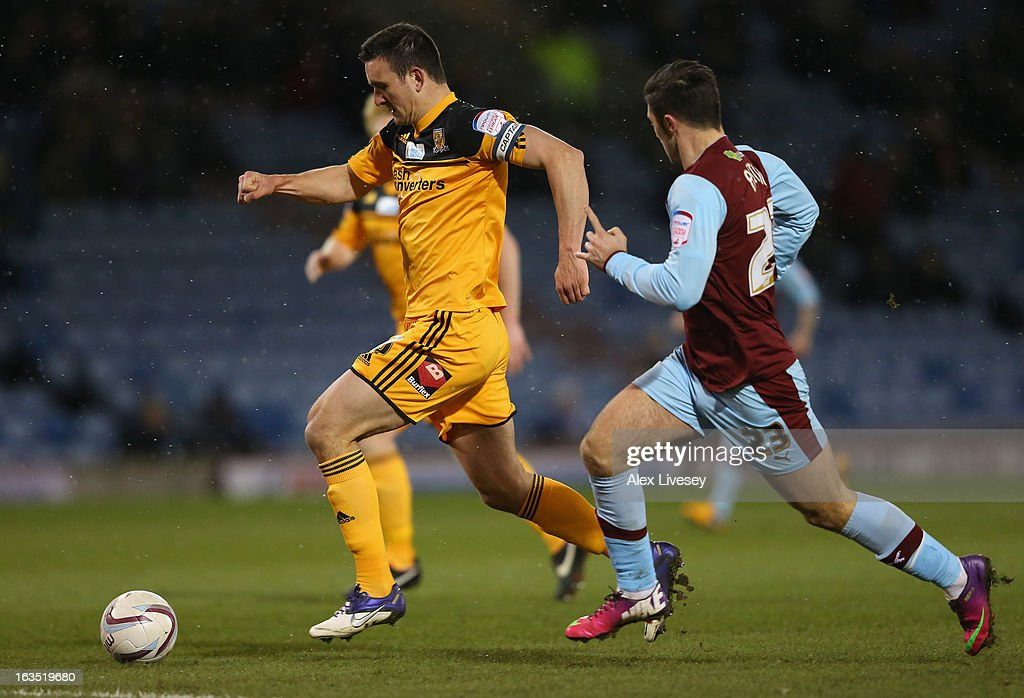 Jack Hobbs of Hull City beats Charlie Austin of Burnley during the npower Championship match between Burnley and Hull City at Turf Moor on March 11, 2013 in Burnley, England.
