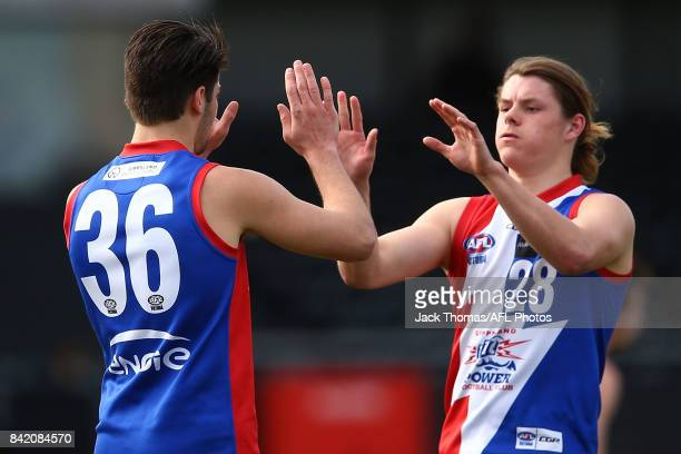 Jack Hudson of the Power celebrates a goal with team mates during the TAC Cup round 18 match between Gippsland and Murray at Victoria Park on...