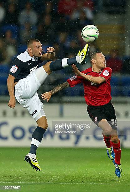Jack Hunt of Huddersfield is challenged by Craig Bellamy of Cardiff during the npower Championship match between Cardiff City and Huddersfield Town...