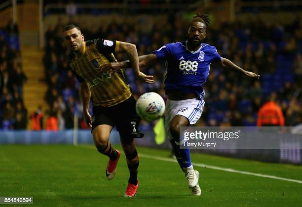 Jack Hunt of Sheffield Wednesday and Jacques Maghoma of Birmingham City battle for possession during the Sky Bet Championship match between...