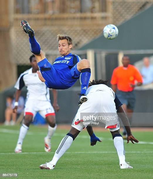 Jack Jewsbury goes upside down fighting Shalrie Joseph for the ball during the New England Revolution game against Kansas City Wizards at Community...