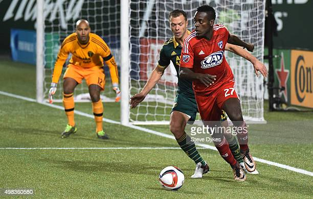 Jack Jewsbury of Portland Timbers defends JeVaughn Watson of FC Dallas as goal keeper Adam Kwarasey of Portland Timbers during the second half of the...