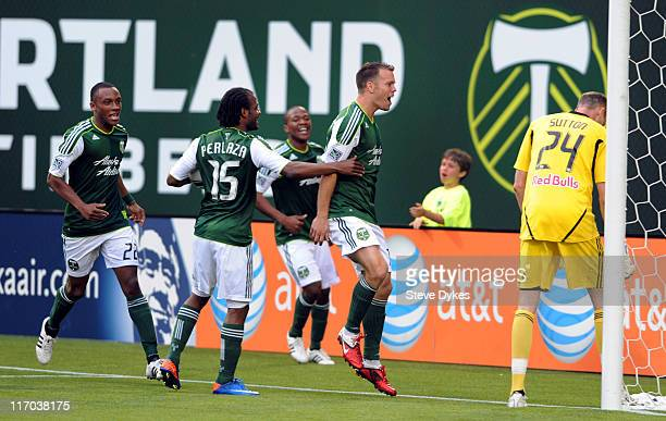 Jack Jewsbury of the Portland Timbers celebrates with his teammates in front of goal keeper Greg Sutton of the New York Red Bulls after scoring a...