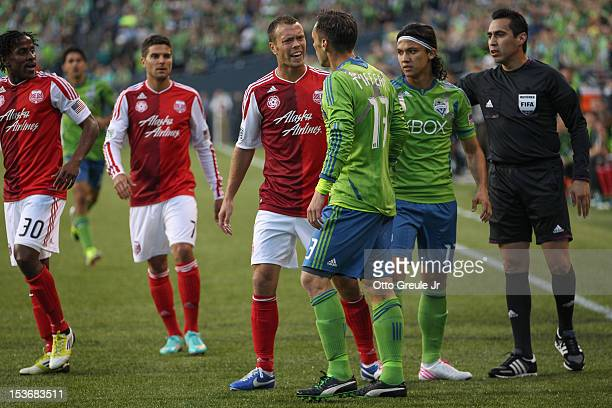 Jack Jewsbury of the Portland Timbers exchanges words with Christian Tiffert of the Seattle Sounders FC at CenturyLink Field on October 7 2012 in...
