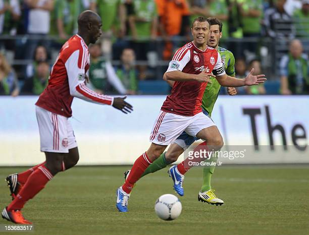 Jack Jewsbury of the Portland Timbers follows the play along with Mamadou 'Futty' Danso against the Seattle Sounders FC at CenturyLink Field on...