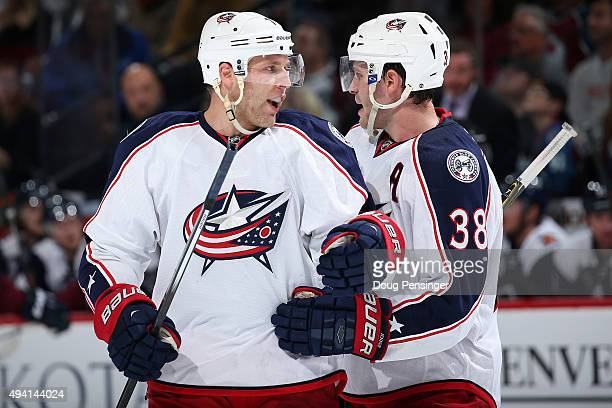 Jack Johnson and Boone Jenner of the Columbus Blue Jackets talk as they face the Colorado Avalanche at Pepsi Center on October 24 2015 in Denver...