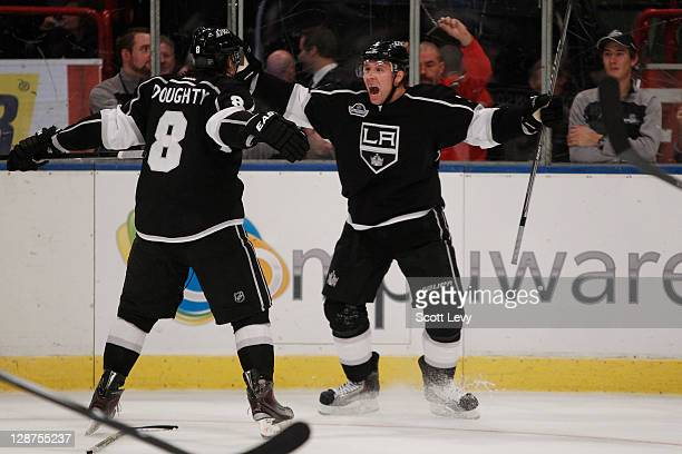 Jack Johnson and Drew Doughty of the Los Angeles Kings celebrate Johnson's gamewinning overtime goal in the game against the New York Rangers at the...