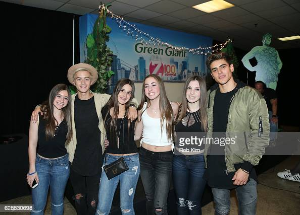Jack Johnson and Jack Gilinsky of the band Jack Jack pose for a photo with guests during Z100 CocaCola All Access Lounge at Z100's Jingle Ball 2016...