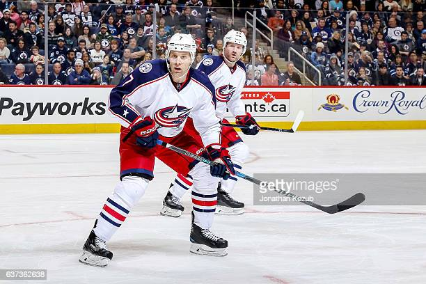 Jack Johnson and Scott Hartnell of the Columbus Blue Jackets keep an eye on the play during second period action against the Winnipeg Jets at the MTS...