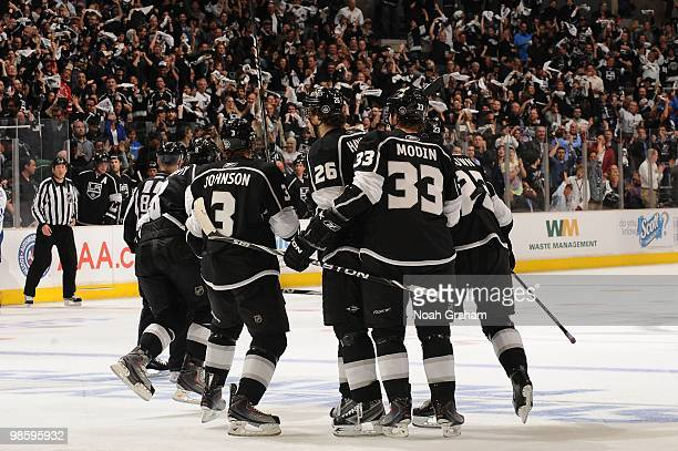 Jack Johnson Michal Handzus Fredrik Modin and Dustin Brown of the Los Angeles Kings skate off the ice after a goal against the Vancouver Canucks in...