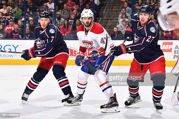 Jack Johnson of the Columbus Blue Jackets Alexander Radulov of the Montreal Canadiens and Ryan Murray of the Columbus Blue Jackets follow the puck...