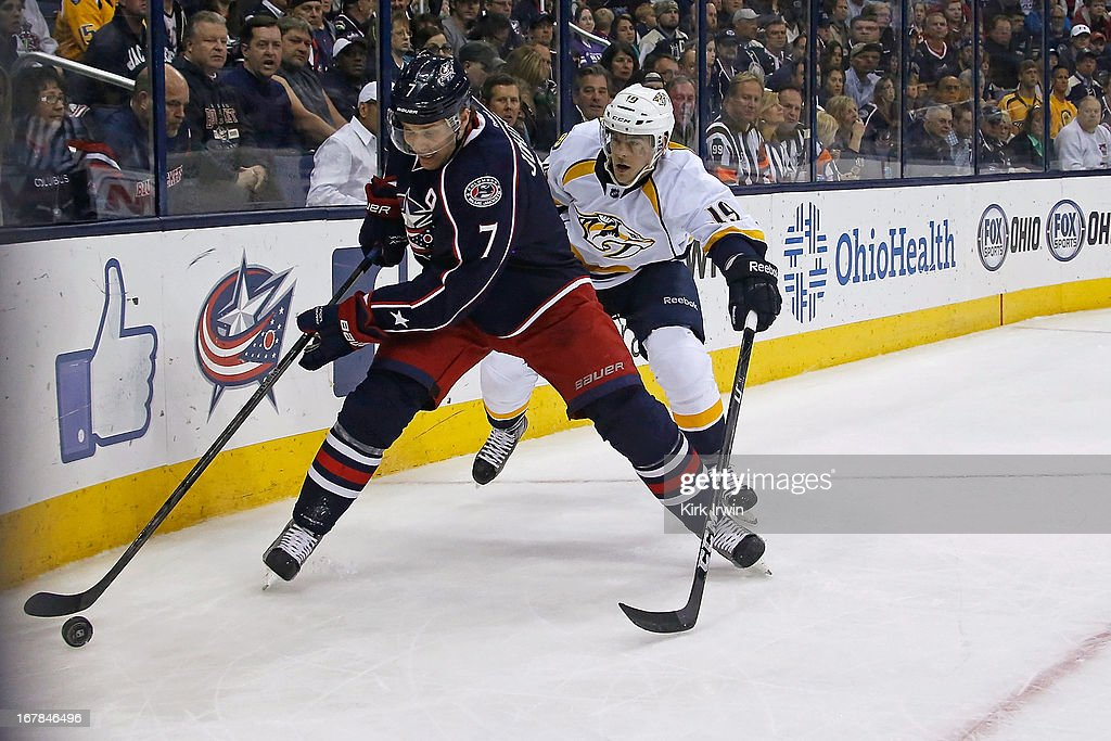 Jack Johnson of the Columbus Blue Jackets and Bobby Butler of the Nashville Predators battle for control of a loose puck on April 27 2013 at...
