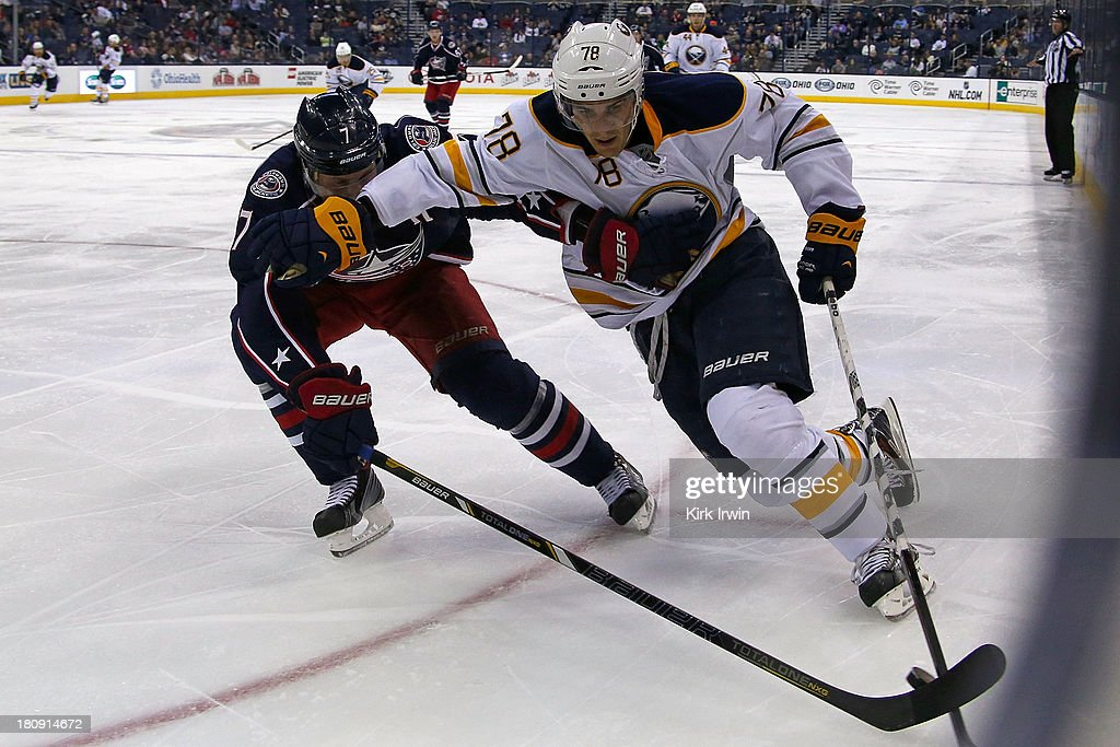 Jack Johnson #7 of the Columbus Blue Jackets and Corey Tropp #78 of the Buffalo Sabres battle for control of the puck on September, 2013 at Nationwide Arena in Columbus, Ohio. Buffalo defeated Columbus 3-1.