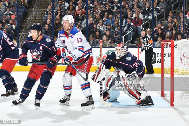 Jack Johnson of the Columbus Blue Jackets and Kevin Hayes of the New York Rangers battle for position as goaltender Sergei Bobrovsky of the Columbus...