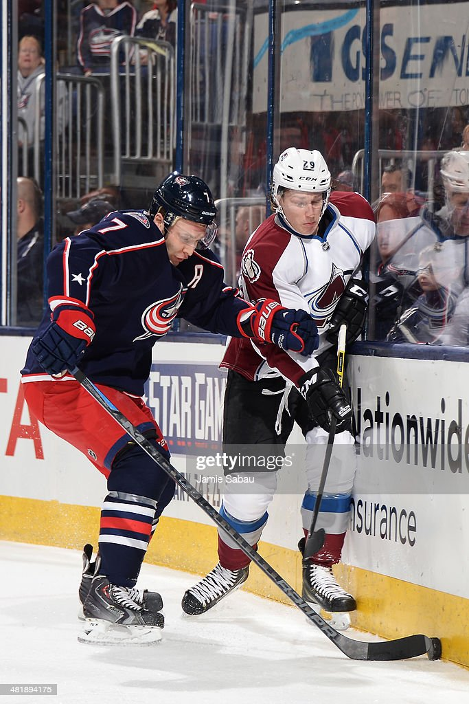Jack Johnson #7 of the Columbus Blue Jackets and Nathan MacKinnon #29 of the Colorado Avalanche battle for the puck during the first period on April 1, 2014 at Nationwide Arena in Columbus, Ohio.