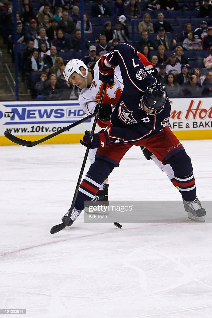 Jack Johnson #7 of the Columbus Blue Jackets and <a gi-track='captionPersonalityLinkClicked' href=/galleries/search?phrase=Tim+Jackman&family=editorial&specificpeople=2077074 ng-click='$event.stopPropagation()'>Tim Jackman</a> #15 of the Calgary Flames battle for control of the puck during the third period on March 22, 2013 at Nationwide Arena in Columbus, Ohio. Columbus defeated Calgary 5-1.