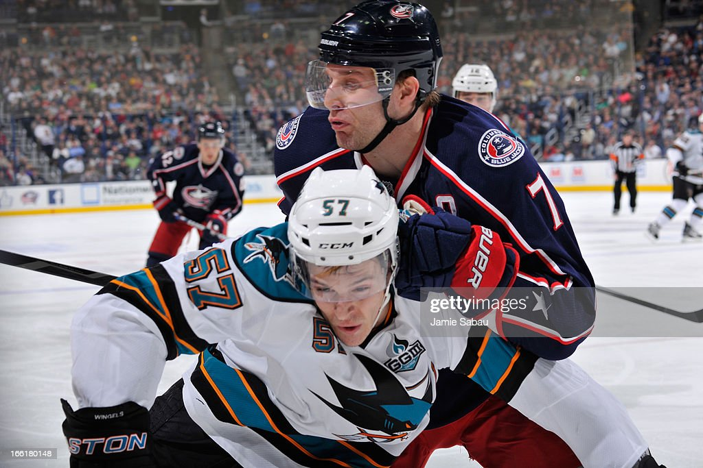 Jack Johnson #7 of the Columbus Blue Jackets attempts to push <a gi-track='captionPersonalityLinkClicked' href=/galleries/search?phrase=Tommy+Wingels&family=editorial&specificpeople=5807738 ng-click='$event.stopPropagation()'>Tommy Wingels</a> #57 of the San Jose Sharks off the puck during the second period on April 9, 2013 at Nationwide Arena in Columbus, Ohio.