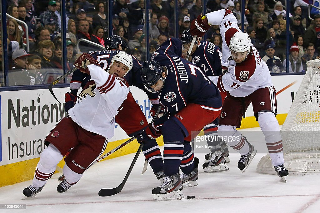 Jack Johnson #7 of the Columbus Blue Jackets battles for control of a loose puck with Martin Hanzal #11 of the Phoenix Coyotes and Steve Sullivan #26 of the Phoenix Coyotes during the third period on March 16, 2013 at Nationwide Arena in Columbus, Ohio. Columbus defeated Phoenix 1-0 in a shootout.