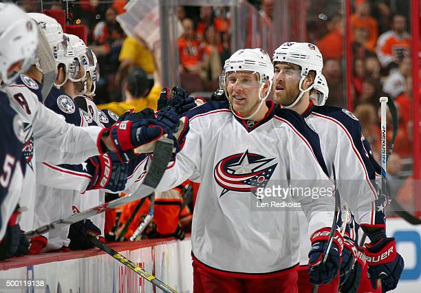 Jack Johnson of the Columbus Blue Jackets celebrates his first period goal against the Philadelphia Flyers with his teammates on the bench on...