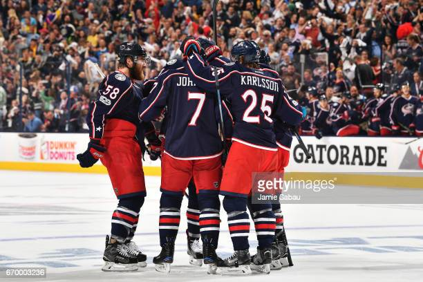 Jack Johnson of the Columbus Blue Jackets celebrates his first period goal with his fellow teammates in Game Four of the Eastern Conference First...