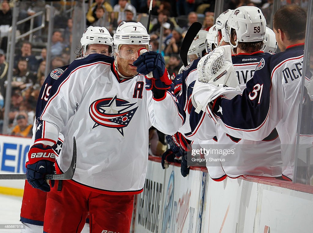 Jack Johnson #7 of the Columbus Blue Jackets celebrates his goal with the bench during the third period against the Pittsburgh Penguins in Game Two of the First Round of the 2014 Stanley Cup Playoffs at Consol Energy Center on April 19, 2014 in Pittsburgh, Pennsylvania.