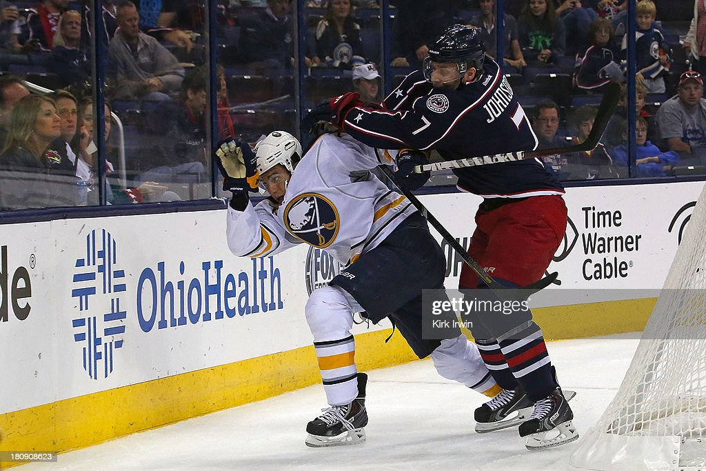 Jack Johnson #7 of the Columbus Blue Jackets checks Corey Tropp #78 of the Buffalo Sabres while chasing after the puck during the first period on September, 2013 at Nationwide Arena in Columbus, Ohio.