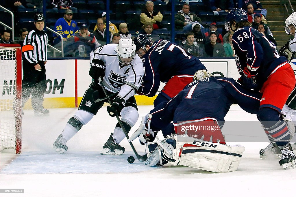 Jack Johnson #7 of the Columbus Blue Jackets checks Mike Richards #10 of the Los Angeles Kings as he gathers the puck from behind Steve Mason #1 of the Columbus Blue Jackets and scores during the third period on February 5, 2013 at Nationwide Arena in Columbus, Ohio. Los Angeles defeated Columbus 4-2.