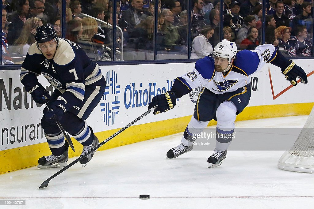 Jack Johnson #7 of the Columbus Blue Jackets clears the puck away from Patrik Berglund #21 of the St. Louis Blues during the third period on April 12, 2013 at Nationwide Arena in Columbus, Ohio. Columbus defeated St. Louis 4-1.
