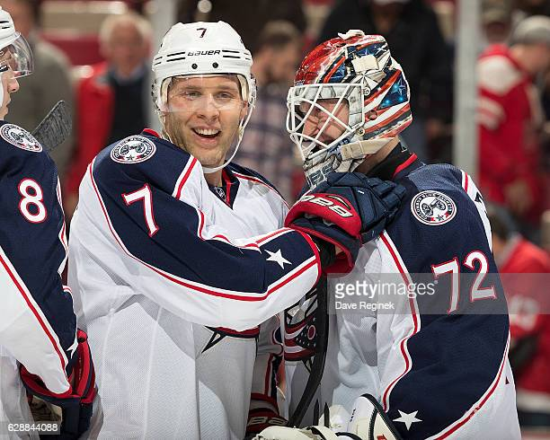 Jack Johnson of the Columbus Blue Jackets congratulates teammate Sergei Bobrovsky after an NHL game against the Detroit Red Wings at Joe Louis Arena...