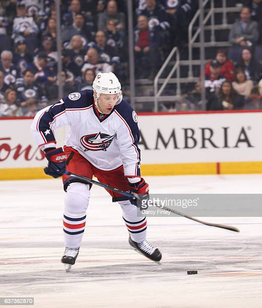 Jack Johnson of the Columbus Blue Jackets gets set to shoot the puck down the ice during third period action against the Winnipeg Jets at the MTS...