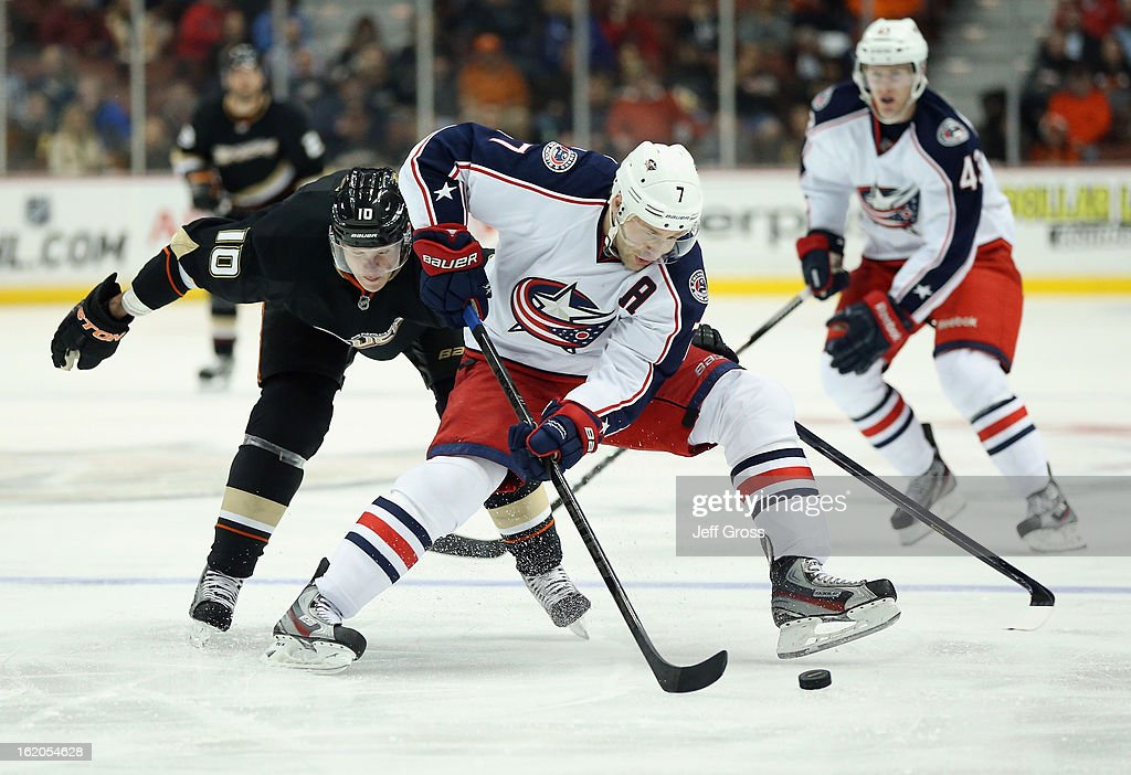 Jack Johnson #7 of the Columbus Blue Jackets is pursued by Corey Perry #10 of the Anaheim Ducks for the puck in the first period at Honda Center on February 18, 2013 in Anaheim, California.