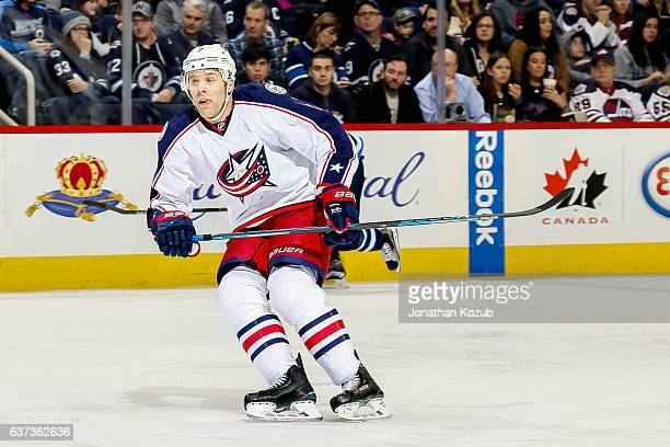 Jack Johnson of the Columbus Blue Jackets keeps an eye on the play during second period action against the Winnipeg Jets at the MTS Centre on...