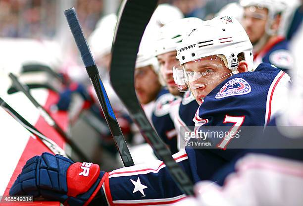 Jack Johnson of the Columbus Blue Jackets looks on from the bench during their NHL game against the Vancouver Canucks at Rogers Arena March 19 2015...
