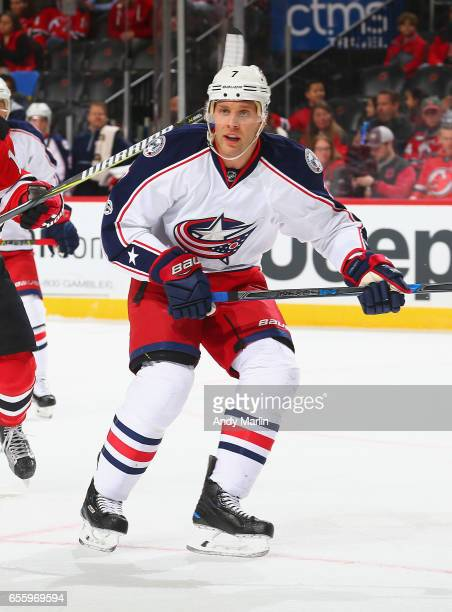 Jack Johnson of the Columbus Blue Jackets playing in his 700th career NHL game skates in the firstperiod against the New Jersey Devils during the...