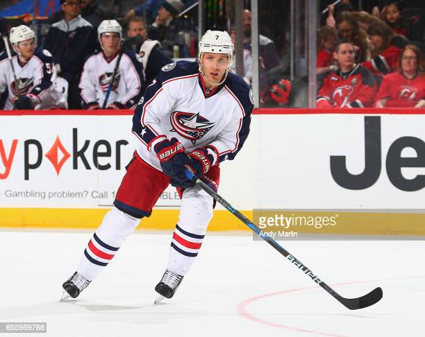 Jack Johnson of the Columbus Blue Jackets playing in his 700th career NHL game skates against the New Jersey Devils during the game at Prudential...