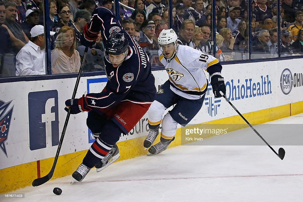 Jack Johnson of the Columbus Blue Jackets skates the puck away from Bobby Butler of the Nashville Predators during the first period on April 27 2013...