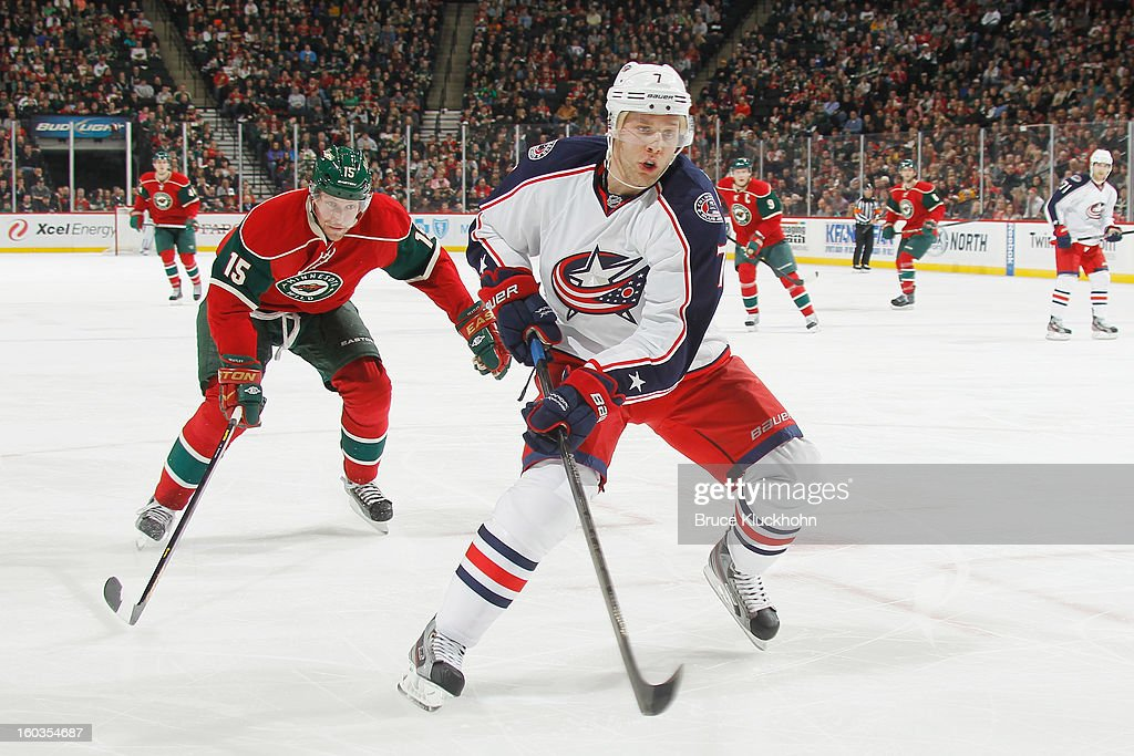 Jack Johnson #7 of the Columbus Blue Jackets skates to the puck with <a gi-track='captionPersonalityLinkClicked' href=/galleries/search?phrase=Dany+Heatley&family=editorial&specificpeople=202142 ng-click='$event.stopPropagation()'>Dany Heatley</a> #15 of the Minnesota Wild defending during the game on January 29, 2013 at the Xcel Energy Center in Saint Paul, Minnesota.