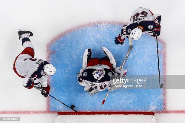 Jack Johnson of the Columbus Blue Jackets stops the puck behind goalie Joonas Korpisalo during the game against the Chicago Blackhawks at the United...